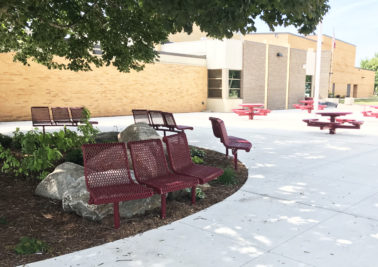 small red benches