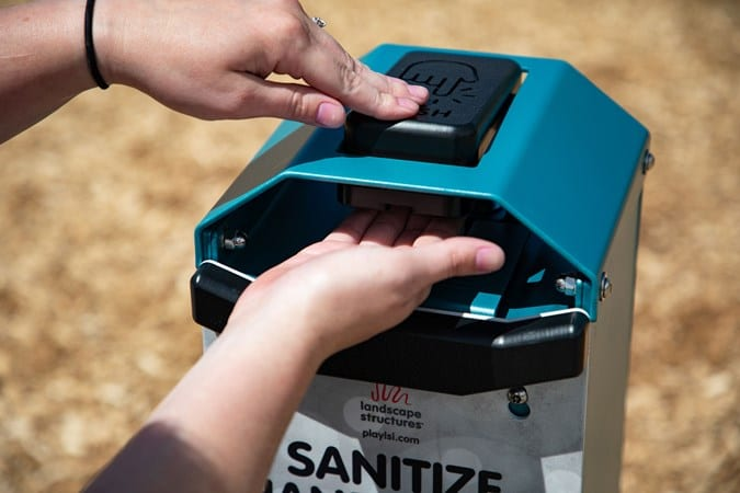 hand sanitizer station being used
